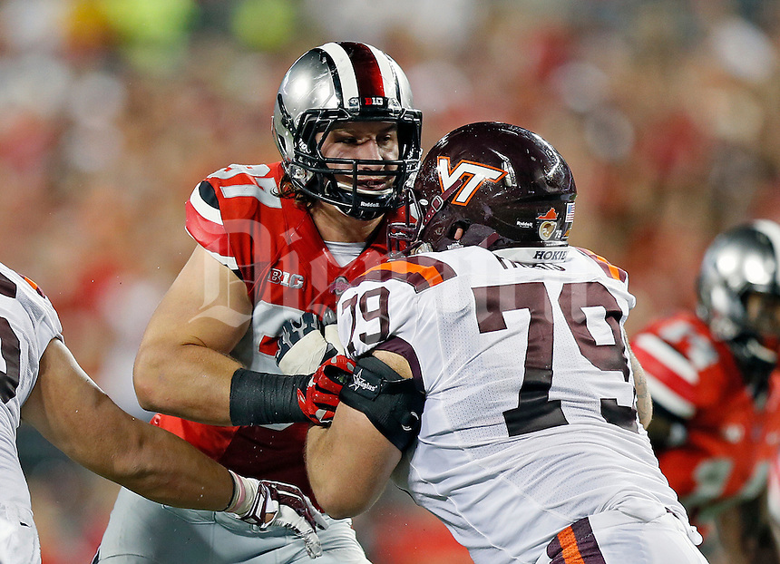 Ohio State Buckeyes defensive lineman Joey Bosa (97) against Virginia Tech Hokies during their NCAA college football game in Ohio Stadium on September 6, 2014.  (Dispatch photo by Kyle Robertson)