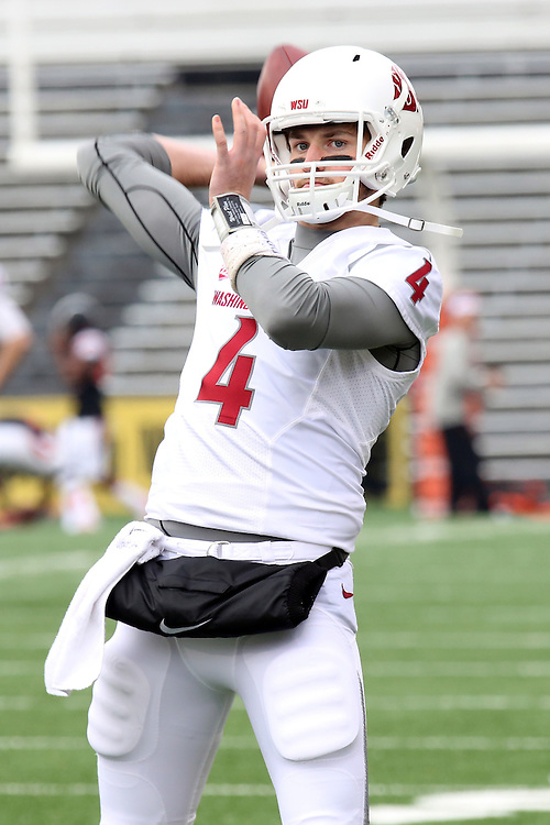 Luke Falk warms before before his first Pac-12 start at quarterback against the Oregon State Beavers at Reser Stadium in Corvallis, Oregon, on November 8, 2014.  Falk threw for 471 yards and 5 touchdowns in his debut, and Washington State defeated the Beavers, 39-32.