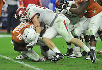 NWA Media/Michael Woods --12/29/2014-- w @NWAMICHAELW...University of Arkansas linebacker Brooks Ellis helps sack Texas quarterback Tyrone Swoops in the 3rd quarter of the Razorbacks 31-7 win during the Texas Bowl Monday night at  NRG Stadium in Houston.