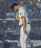 Joey Lucchesi pitcher inicial de San Diego lanza la pelota bajo la intensa lluvia, durante el partido de beisbol de los Dodgers de Los Angeles contra Padres de San Diego, durante el primer juego de la serie las Ligas Mayores del Beisbol en Monterrey, Mexico el 4 de Mayo 2018.<br /> (Photo: Luis Gutierrez)