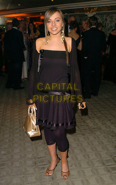 LOUISA LYTTON.The Chocolate Ball,.The Dorchester, London, England, .March 24th 2006..full length black leggings dress gold bag shoes.Ref: CAN.www.capitalpictures.com.sales@capitalpictures.com.©Capital Pictures