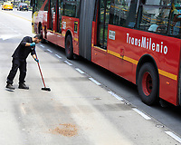 """BOGOTA, COLOMBIA - March 13:  A worker cleans a public transportation station  """"Transmilenio"""" on March 13, 2020 in Bogota, Colombia. The World Health Organization declared a global pandemic as the coronavirus rapidly spreads across the world. Colombian President Ivan Duque declared a health emergency to contain an outbreak of coronavirus, suspending public events with more than 500 people. (Photo by John W. Vizcaino/VIEWpress via Getty Images)"""
