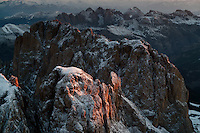 The Italian Dolomites near Balzano are a unique corner of the Alps with disctinct geology.  Vertical reefs from ancient seas glow in the morning light.<br /> Aerials of the Alps just outside Ortisei, Italy.