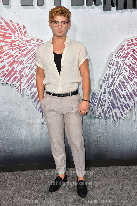 "LOS ANGELES, CA. August 28, 2018: Garrett Clayton at the world premiere of ""Peppermint"" at the Regal LA Live."
