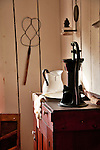 A room with an antique washing bowl and water pump in one of the houses at Heritage Village in Florida, a living museum park made up of 21 acres with historical buildings from around Florida that were built in the 19th century