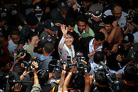 Myanmar's pro-democracy leader Aung San Suu Kyi greets migrant workers from her country as she visits the Samut Sakhon province where their live May 30, 2012. Nobel Peace Prize winner Suu Kyi ventures outside Myanmar for the first time in 24 yearson Tuesday in an unmistakable display of confidence in the liberalisation taking shape in her country after five decades of military rule. REUTERS/Damir Sagolj (THAILAND)