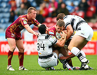 PICTURE BY VAUGHN RIDLEY/SWPIX.COM - Rugby League - Super League - Huddersfield Giants v Hull FC - Galpharm Stadium, Huddersfield, England - 09/04/12 - Huddersfield's Larne Patrick is tackled by Hull FC's Jay Pitts and Josh Bowden.