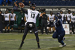 Hawaii quarterback Cole McDonald (13) throws as he is rushed by Nevada defensive end Dom Peterson in the second half of an NCAA college football game in Reno, Nev. Saturday, Sept. 28, 2019. (AP Photo/Tom R. Smedes)
