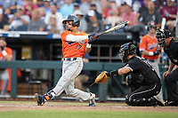 Auburn Tigers shortstop Will Holland (17) follows through on his swing during Game 4 of the NCAA College World Series against the Mississippi State Bulldogs on June 16, 2019 at TD Ameritrade Park in Omaha, Nebraska. Mississippi State defeated Auburn 5-4. (Andrew Woolley/Four Seam Images)