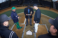 Notre Dame Fighting Irish head coach Mik Aoki (left) and Wake Forest Demon Deacons head coach Tom Walter (right) meet with home plate umpire Gregory Street to exchange lineups prior to the game at David F. Couch Ballpark on March 10, 2019 in  Winston-Salem, North Carolina. The Demon Deacons defeated the Fighting Irish 7-4 in game one of a double-header.  (Brian Westerholt/Four Seam Images)