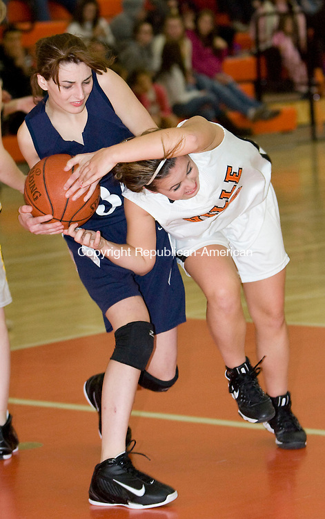 TORRINGTON, CT - 11 DECEMBER 2009 -121109JT12--<br /> Terryville's Shelby Bissonnette and Wolcott Tech's Jen Hislop battle for the ball during Friday's game at Terryville. Terryville won, 65-23.<br /> Josalee Thrift Republican-American