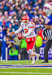 9 November 2014: Kansas City Chiefs punter Dustin Colquitt kicks to the Buffalo Bills in the second quarter at Ralph Wilson Stadium in Orchard Park, NY. The Chiefs rallied with two fourth quarter touchdowns to defeat the Bills 17-13. Mandatory Credit: Ed Wolfstein Photo *** RAW (NEF) Image File Available ***