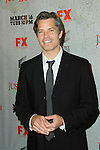 TIMOTHY OLYPHANT. Arrivals to the premiere screening of the FX original drama series, Justified, at the Directors Guild of America. Los Angeles, CA, USA. March 8, 2010.