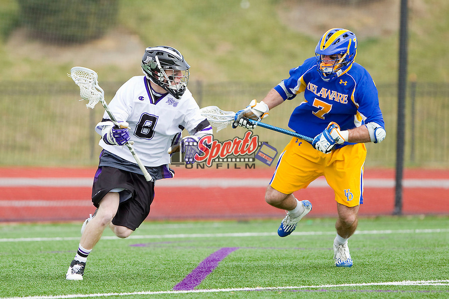 Matt Thistle (8) of the High Point Panthers tries to avoid the pursuit of Elijah Conte (7) of the Delaware Blue Hens at Vert Track, Soccer & Lacrosse Stadium on February 2, 2013 in High Point, North Carolina.  The Blue Hens defeated the Panthers 12-10.   (Brian Westerholt/Sports On Film)