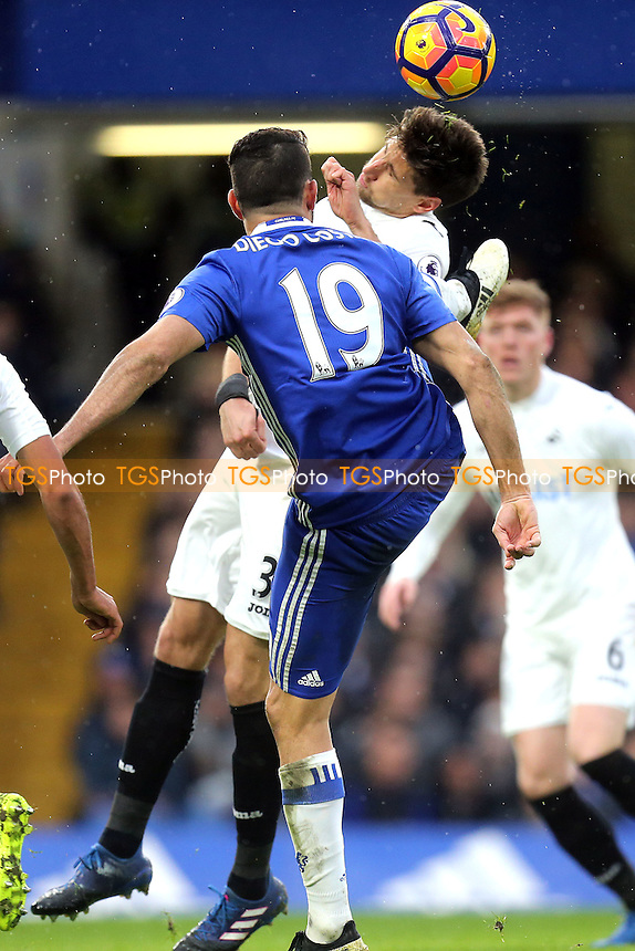 Diego Costa of Chelsea and Federico Fernandez of Swansea City during Chelsea vs Swansea City, Premier League Football at Stamford Bridge on 25th February 2017