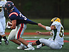 Nick LiCalzi #33 of South Side, left, fights for ground yards as Kyle Serro #55 of Lynbrook gets a hold of his jersey during a Nassau County Conference III varsity football game at South Side High School in Rockville Centre on Thursday, Sept. 27, 2018. LiCalzi scored two touchdowns in South Side's 28-13 win.