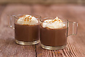 Hot chocolate drink in two glass mugs with whipped cream