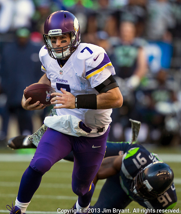 Minnesota Vikings Christian Ponder (7)  scrambles against the Seattle Seahawks at CenturyLink Field in Seattle, Washington on  November 17, 2013.  The Seahawks beat the Vikings 41-20.  ©2013.  Jim Bryant. All Rights Reserved.
