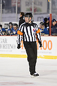 Referee Darcy Burchell (42) during the third period of The Frozen Frontier outdoor AHL game at Frontier Field on December 13, 2013 in Rochester, New York.  (Copyright Mike Janes Photography)