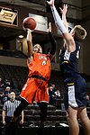 SIOUX FALLS, SD - MARCH 8:  Dominique Lindsey # from Union shoots over the defense of Samuel Guymon #20 from Marian at the 2018 NAIA DII Men's Basketball Championship at the Sanford Pentagon in Sioux Falls. (Photo by Dave Eggen/Inertia)