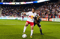 Tim Cahill (17) of the New York Red Bulls holds off Seth Sinovic (16) of Sporting Kansas City. The New York Red Bulls and Sporting Kansas City played to a 0-0 tie during a Major League Soccer (MLS) match at Red Bull Arena in Harrison, NJ, on October 20, 2012.