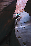 Kassie pretends she is spiderwoman climbing up pecked moqui steps in Buckskin Gulch, AZ.<br /> <br /> To see more Adventure photos, please check out my Get Out There Gallery!