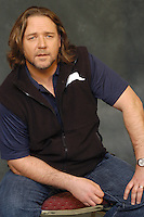 """RUSSELL CROWE.Photocall for """"3:10 To Yuma"""", Rome, Italy..October 16th, 2007.three ten 310 3 10 half length black sleeveless top blue t tee shirt sitting stubble facial hair .CAP/CAV.©Luca Cavallari/Capital Pictures."""