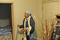 Carol McClelland in her new rental at 8231 S. Houston St. in Chicago, Illinois on December 1, 2008.  McClelland was the victim of mortgage fraud when a third party promised to renegotiate her mortgage on her old house at 7618 S. Carpenter with her lenders - for a fee - and then did nothing; McClelland, who works at a soul food restaurant, lost her home.