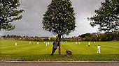 Scottish National Cricket League, Premier Div - Heriots V Uddingston ay Goldenacre, Edinburgh - a spectator and roller lean on a tree while watching the game, which was won by Uddingston, unfolds - Picture by Donald MacLeod - 16 May 2009
