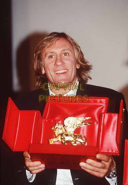 GERARD DEPARDIEU .At The Venice Film Festival.Ref: MAX.gold statue, red case, half length, half-length.www.capitalpictures.com.sales@capitalpictures.com.© Capital Pictures