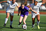 Collinsville midfielder Destiny Johnson (center) appears to be momentarily restrained by Belleville East players Alexandra Muleer (left) and Annie Brown in the first extra period following regulation. Collinsville defeated Belleville East 3-2 on Wednesday May 16, 2018 in a girls regional soccer semifinal game that had been halted on Monday due to bad weather. The game re-started with 2:39 on the clock and the score tied 2-2. Tim Vizer | Special to STLhighschoolsports.com