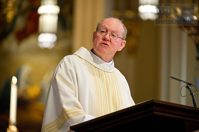 July 26, 2013;  Rev. Timothy Scully, C.S.C., speaks during the annual ACE Missioning Mass at the Basilica of the Sacred Heart. Photo by Barbara Johnston/University of Notre Dame