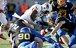 BROOKINGS, SD - NOVEMBER 11: Markel Smith #21 from Illinois State is brought down by Christian Rozeboom #2 from South Dakota State University during their game Saturday afternoon at Dana J. Dykhouse Stadium in Brookings. (Photo by Dave Eggen/Inertia)
