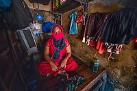 Shiva, a sex-worker in the red-light district of Bombay, India. Shiva is from a neighboring Southeast Asian country and is one of the thousands of young women trafficked every year and sold in sex-slavery. She was married at the age of ten but her husband left her for another women when she was seven months pregnant. After she had the child a woman in her village promised her a job in Mumbai but sold her into a brothel where she was severely beaten until she succumbed to servicing clients.