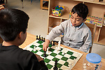 Afterschool chess program for elementary students graduates of Headstart program two boys playing