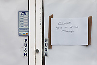 """Pictured: A """"Closed for Business"""" notice outside a shop in Taff Street, Pontypridd. Wednesday 04 March 2020<br /> Re: Revisiting the flood affected areas in Pontypridd, Wales, UK."""