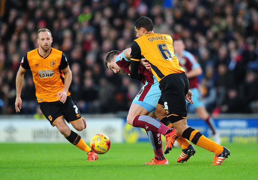 Burnley's Sam Vokes shields the ball from Hull City's Curtis Davies<br /> <br /> Photographer Chris Vaughan/CameraSport<br /> <br /> Football - The Football League Sky Bet Championship - Hull City v Burnley - Saturday 26th December 2015 - Kingston Communications Stadium - Hull<br /> <br /> &copy; CameraSport - 43 Linden Ave. Countesthorpe. Leicester. England. LE8 5PG - Tel: +44 (0) 116 277 4147 - admin@camerasport.com - www.camerasport.com