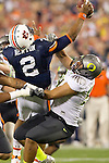 01/09/2011 - Oregon's Zac Clark sacks Auburn quarterback Cam Newtwon in the first half during the BCS National Championship game in Scottsdale, Arizona.