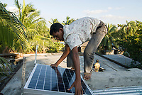 BANGLADESH , Sundarbans, village Burigoalinoi , micro-finance bank Grameen Shakti and NGO Srizony , promote micro-credit financed Solar Home Systems in villages