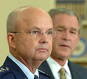 Washington, D.C. - May 8, 2006 --  Air Force General Michael Hayden speaks after United States President George W. Bush named him to be the next Central Intelligence Agency (CIA) Director in the Oval Office of the White House on May 8, 2006. Hayden will replace Porter Goss if confirmed. <br /> Credit: Roger Wollenberg - Pool via CNP