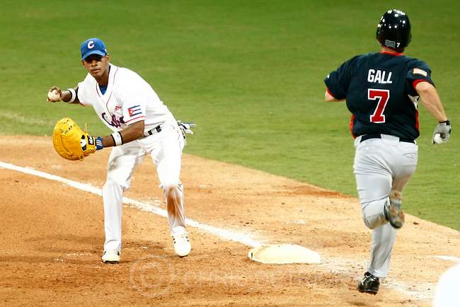 Cuba's Hector Olivera gets out USA's John Gall during the semifinals game at the Wukesong Baseball Field in Beijing, Friday, August 22, 2008.  Cuba won the game 10-2..Chris Detrick/The Salt Lake Tribune.