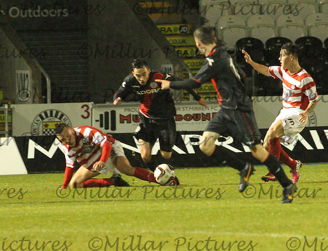Anton Brady fouled by Lee Kilday in the St Mirren v Hamilton Academical Scottish Professional Football League Under 20 match played at St Mirren Park, Paisley on 3.12.13.