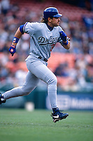 SAN FRANCISCO, CA - Mike Piazza of the Los Angeles Dodgers runs to first base during a game against the San Francisco Giants at Candlestick Park in San Francisco, California in 1996.  Photo by Brad Mangin