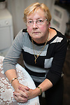 © Joel Goodman - 07973 332324 . 13 November 2013 . Blackley , UK . PHYLLIS ROBINSON (73) (correct) in her home . Phyllis Robinson was robbed of her handbag containing £20,000 - her life savings - in cash after she withdrew the money from her bank to help her daughter , Lynn Richardson , launch her business . Photo credit : Joel Goodman