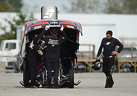 Sept. 30, 2012; Madison, IL, USA: NHRA crew members for funny car driver Cruz Pedregon during the Midwest Nationals at Gateway Motorsports Park. Mandatory Credit: Mark J. Rebilas-