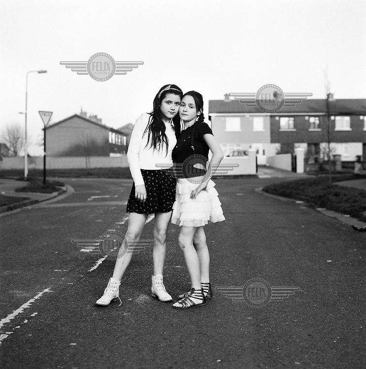 Sisters Margaret and Shannon stand together outside their home on the Jobstown Estate.