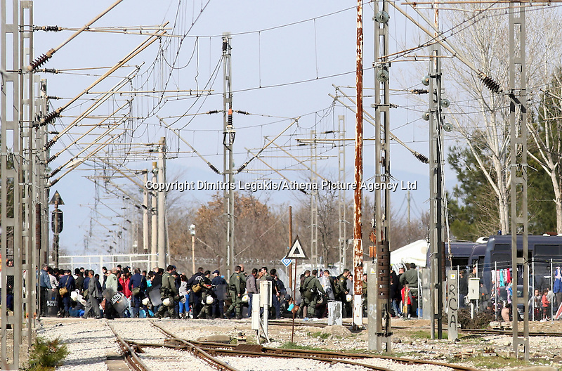 Pictured: Migrants crossing the railway lines Tuesday 23 February 2016<br /> Re: Migrants trying to cross the Greek-FYRO Macedonian border, were turned away by the authorities in Idomeni, Greece.