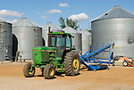 Mid 1980s John Deere 4450 tractor with blue grain auger, steel grain tanks