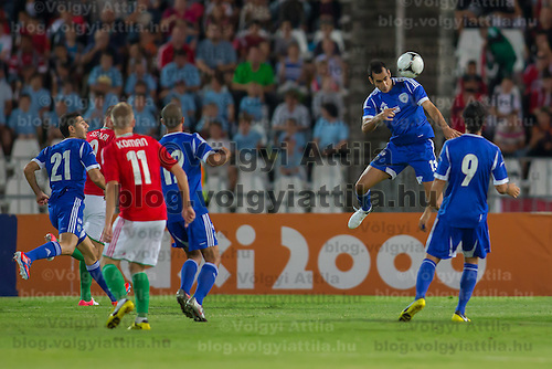 Teammates watch as Israel's Din Mori (C) goes for a header during a f riendly football match Hungary playing against Israel in Budapest, Hungary on August 15, 2012. ATTILA VOLGYI