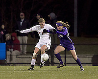 "Boston College defender Alyssa Pember (6) and University of Washington forward Annie Sittauer (20) battle for the ball. In overtime, Boston College defeated University of Washington, 1-0, in NCAA tournament ""Elite 8"" match at Newton Soccer Field, Newton, MA, on November 27, 2010."